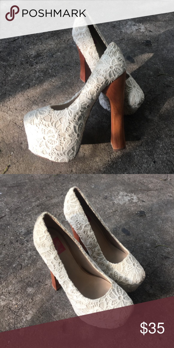 White Lace Platform Heels Good condition, very minor scuffs on the wooden heel. Size 6.5. Perfect for a wedding! Dolce Vita Shoes