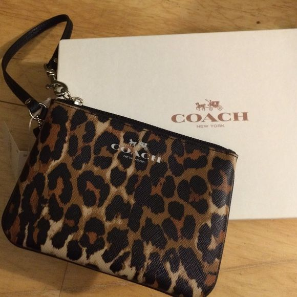 8d1cec16c0 Coach cheetah wristlet Cheetah print COACH wristlet. Perfect condition.  Never been used