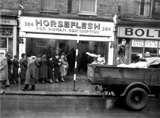This busy scene on 384 Coldharbour Lane, Brixton shows crowds queuing outside a store advertising 'Horse Flesh for Human Consumption' while a lorry unloads more meat. The photo was taken on January 11th 1947 when post-war food rationing was still in full effect, and according to Budgie Byrne, the meat was on sale in Brixton for many years.