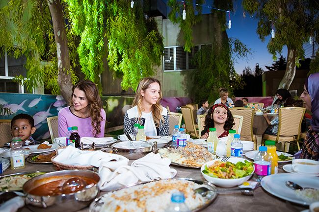 Queen Rania and Princess Iman visiting Al Hussein Social Foundation for Orphans on June 13, 2016 and break their fasting with Iftar with the children from the orphanage