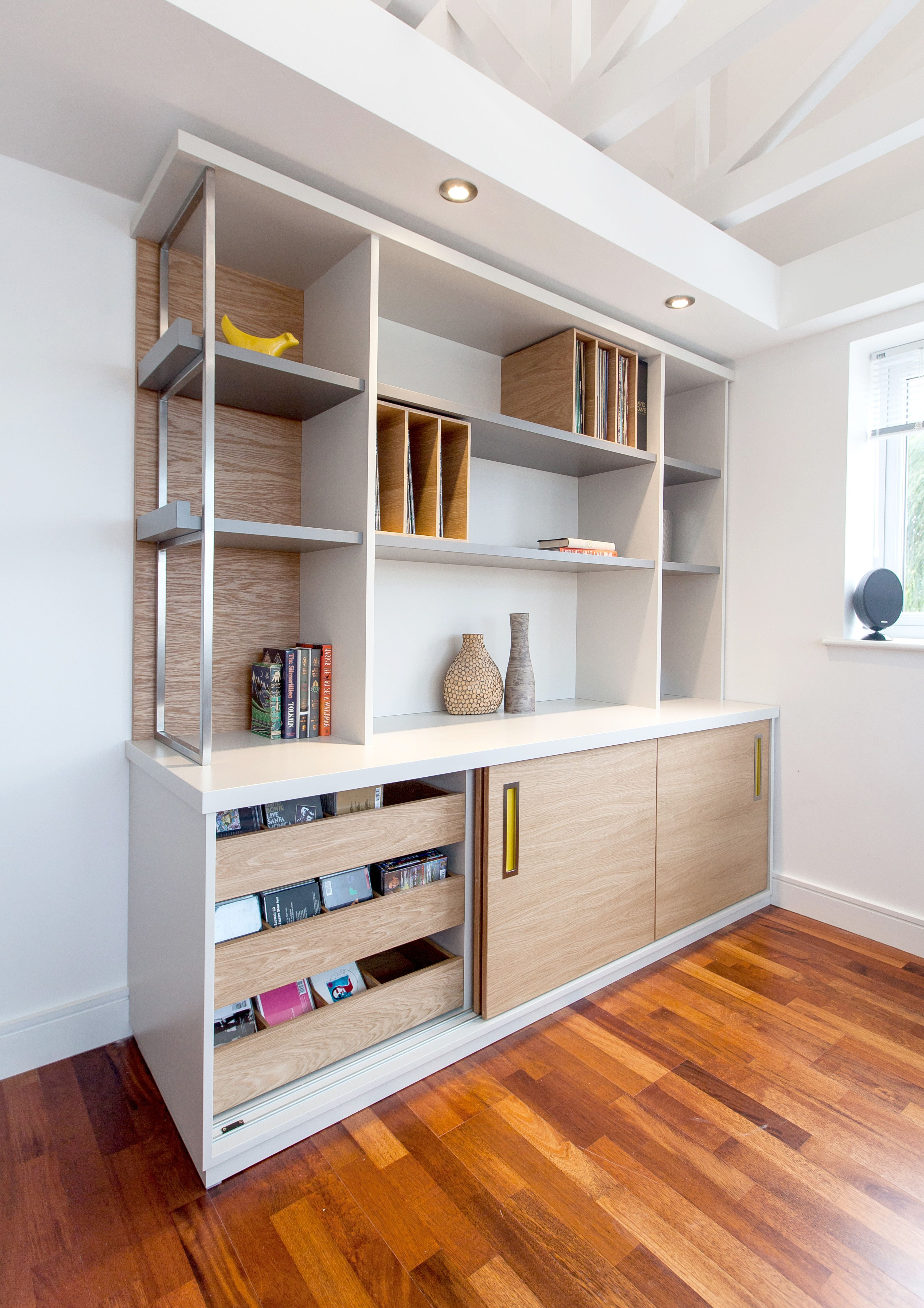 Bespoke Wall Unit In Oak Veneer And Spray Painted Finish With Stainless Steel Ladder Pods Can Be Used For Lp Storage Or Magazines Pops Of Colour From