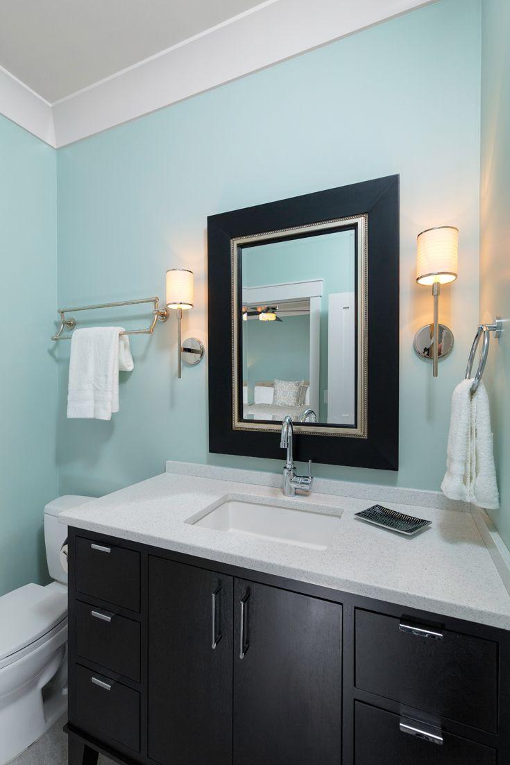Modern coastal bathroom with sleek dark wood cabinetry and granite ...