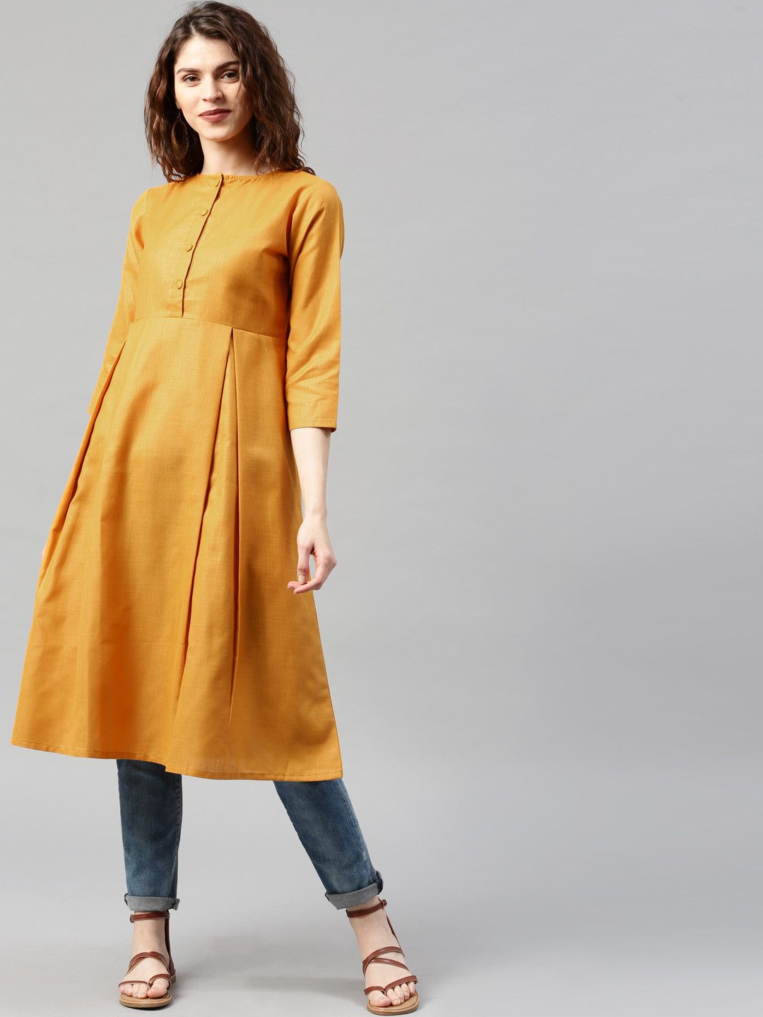18e18c1d7a Buy Libas Mustard Solid Cotton A-Line Pleated Kurta online in India at best  price.Mustard yellow A-line kurta, has a notched round neck, a short button  ...