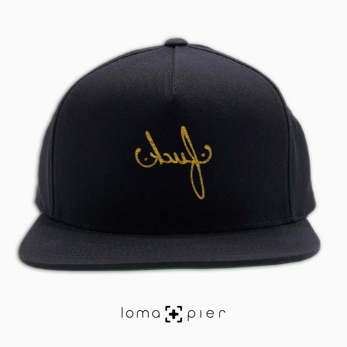 edfd342fbdfbc F CK typography embroidered on a black classic snapback hat with gold  thread by loma