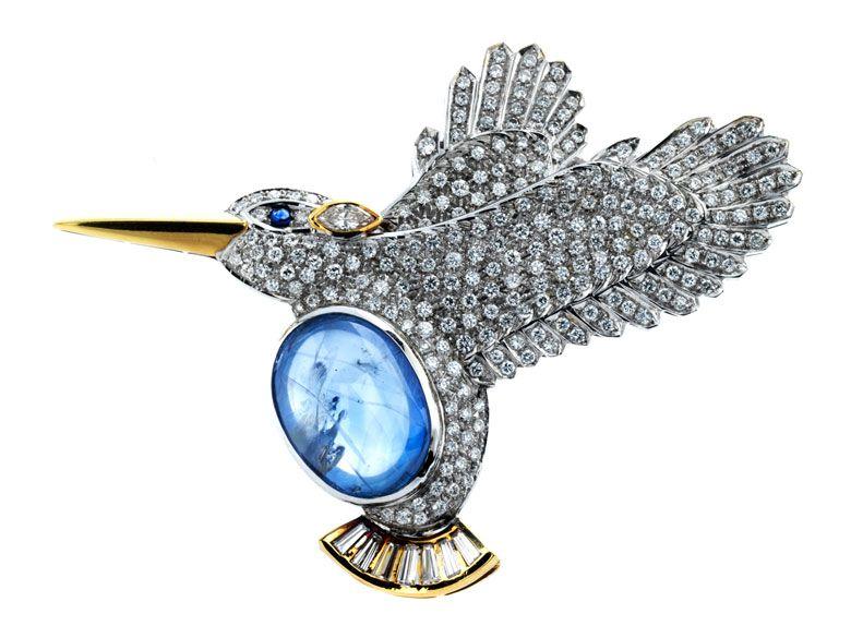 """Länge: ca. 7,4 cm. Höhe: ca. 6 cm. Gewicht: ca. 30,3 g. GG und WG 750. Signiert """"missiaglia"""". Dekorative Vogelbrosche, das Federkleid besetzt mit..."""