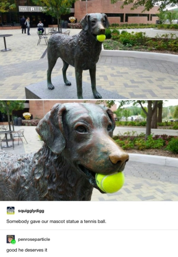 Someone put a tennis ball in the mouth of the mascot statue