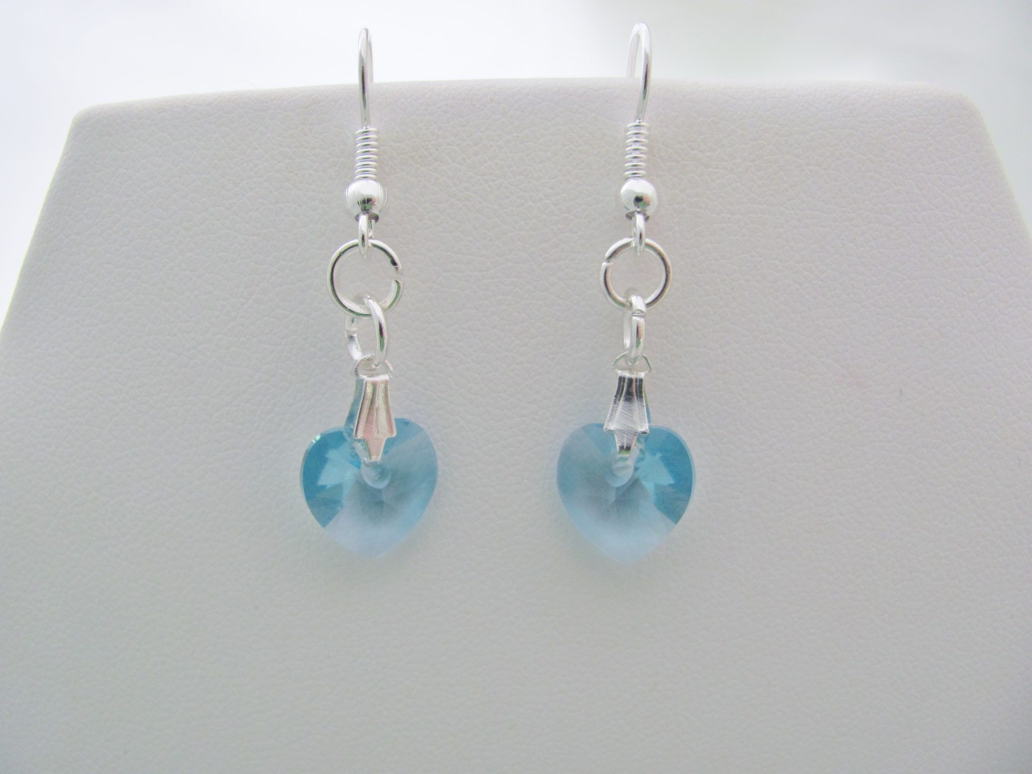 Swarovski Crystal Heart Bead Earrings in Aquamarine, delicate 10mm hearts hanging from silver plated earring wires.  Handmade with genuine Swarovski beads.