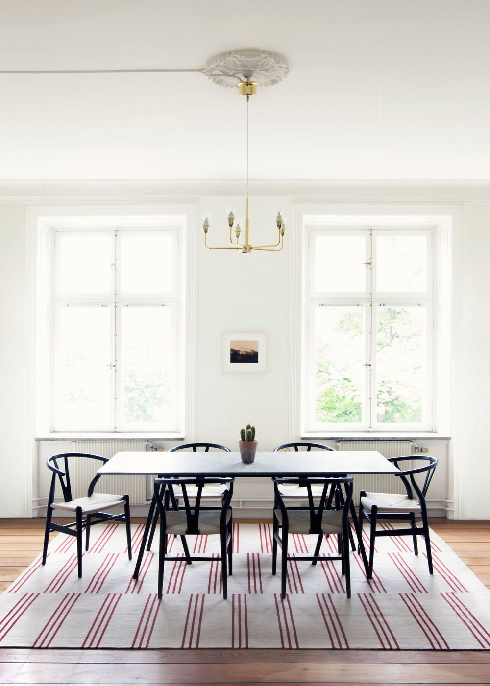 Everything In This Room Is Very Simple In Terms Of Design This Is Offset By The Striped Rug In 2020 Scandinavian Rug Home Scandinavian Design