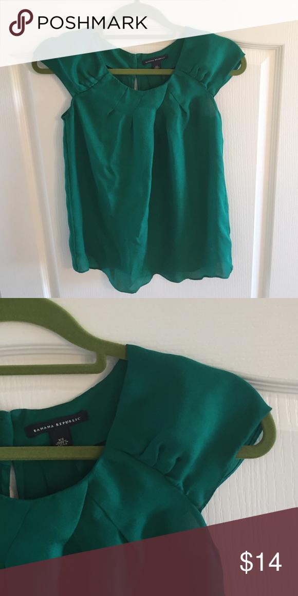 aac1d07eaed576 Banana republic blouse Pretty dark kelly green color. 100% silk. With a cap  shoulder sleeve Banana Republic Tops Blouses