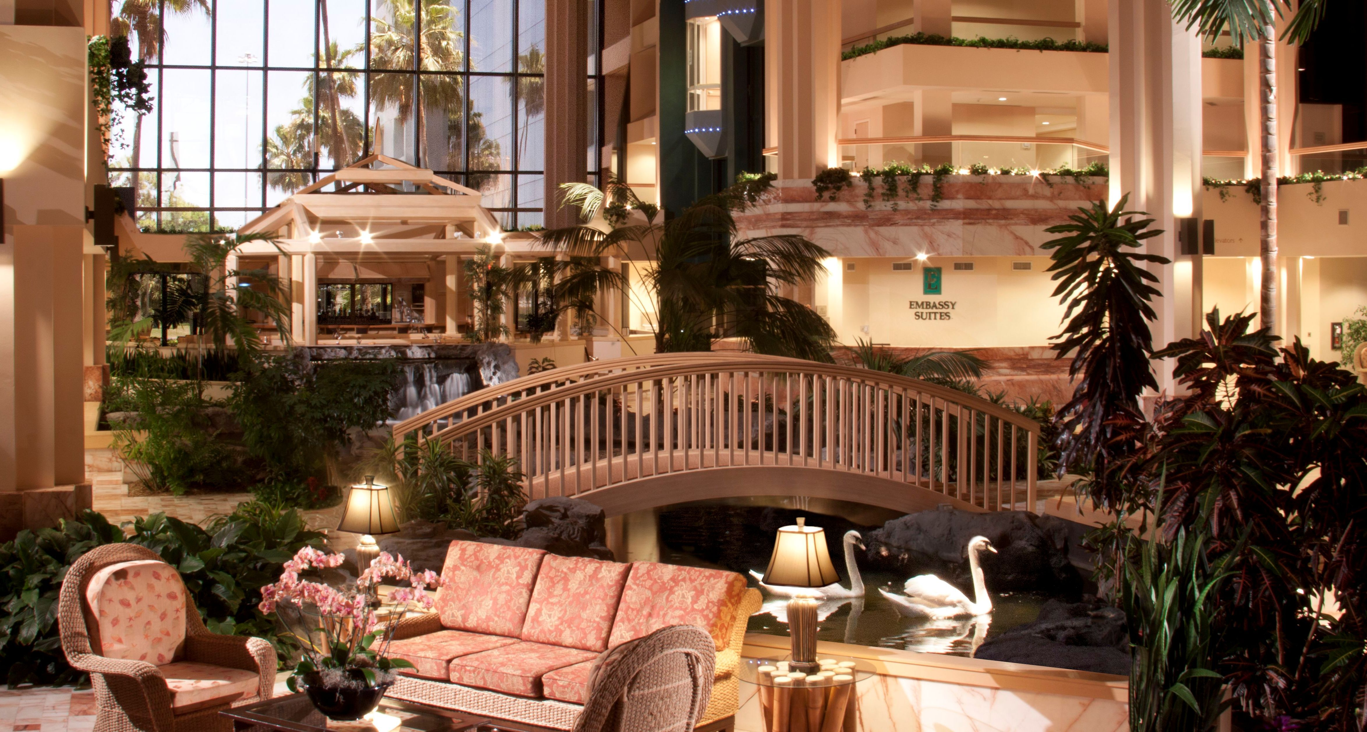 The atrium lobby and reception area of Embassy Suites Palm Beach ...