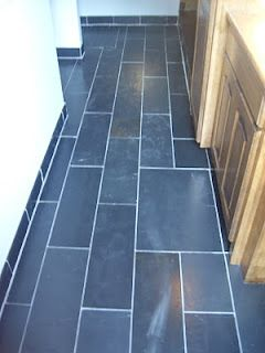 I Like The Bullnose Tile For Baseboard Trim On This Slate Floor