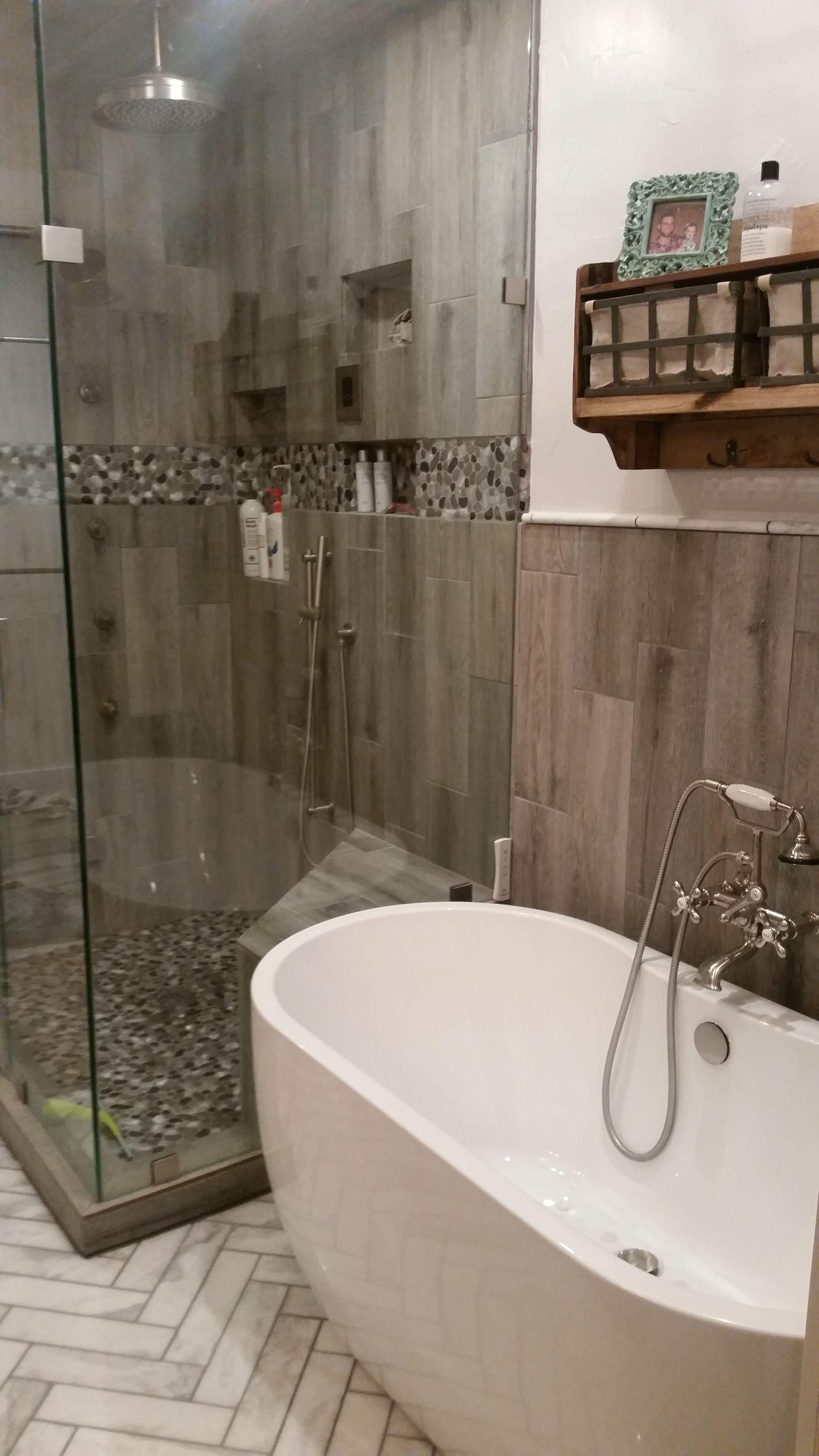 Herringbone carerra marble floors; steam shower with body jets, rain ...