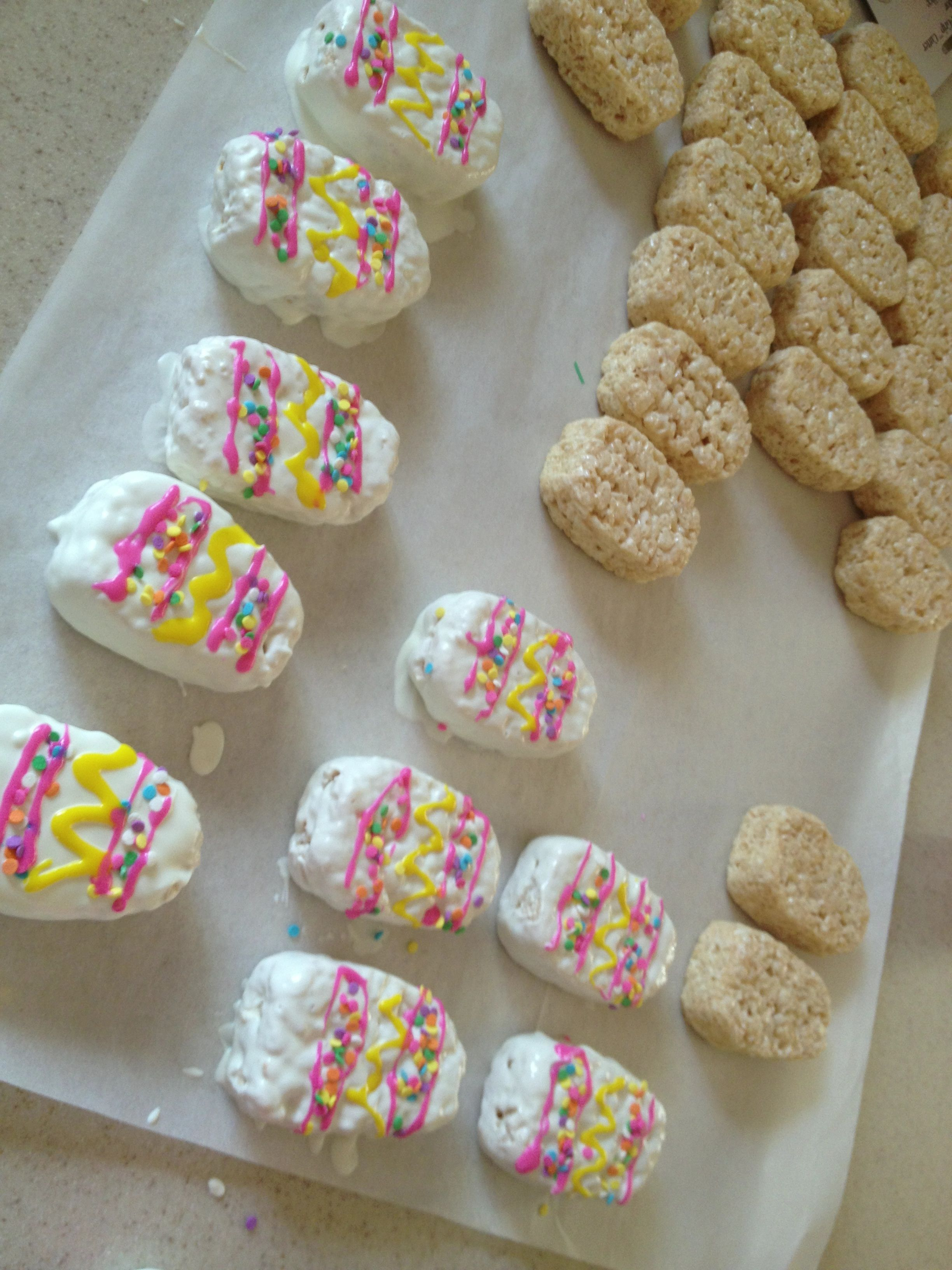 Rice crispy treats shaped like eggs dipped in white chocolate and decorated with sprinkles. I skewered them and wrapped with a clear cellophane bag!