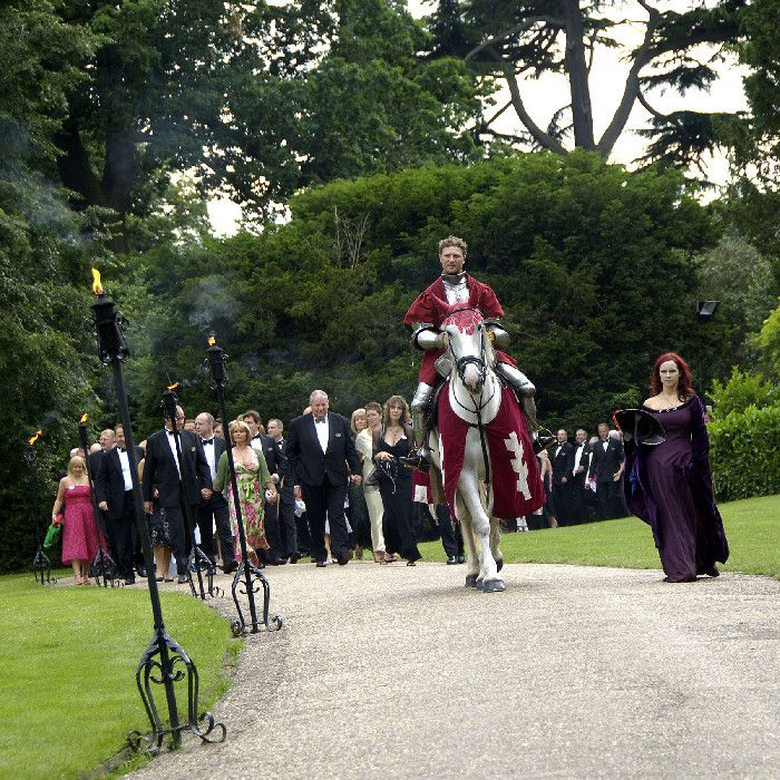 The Red Knight approaches Warwick Castle on horseback. A touch of fantasy at a marvellous wedding venue.