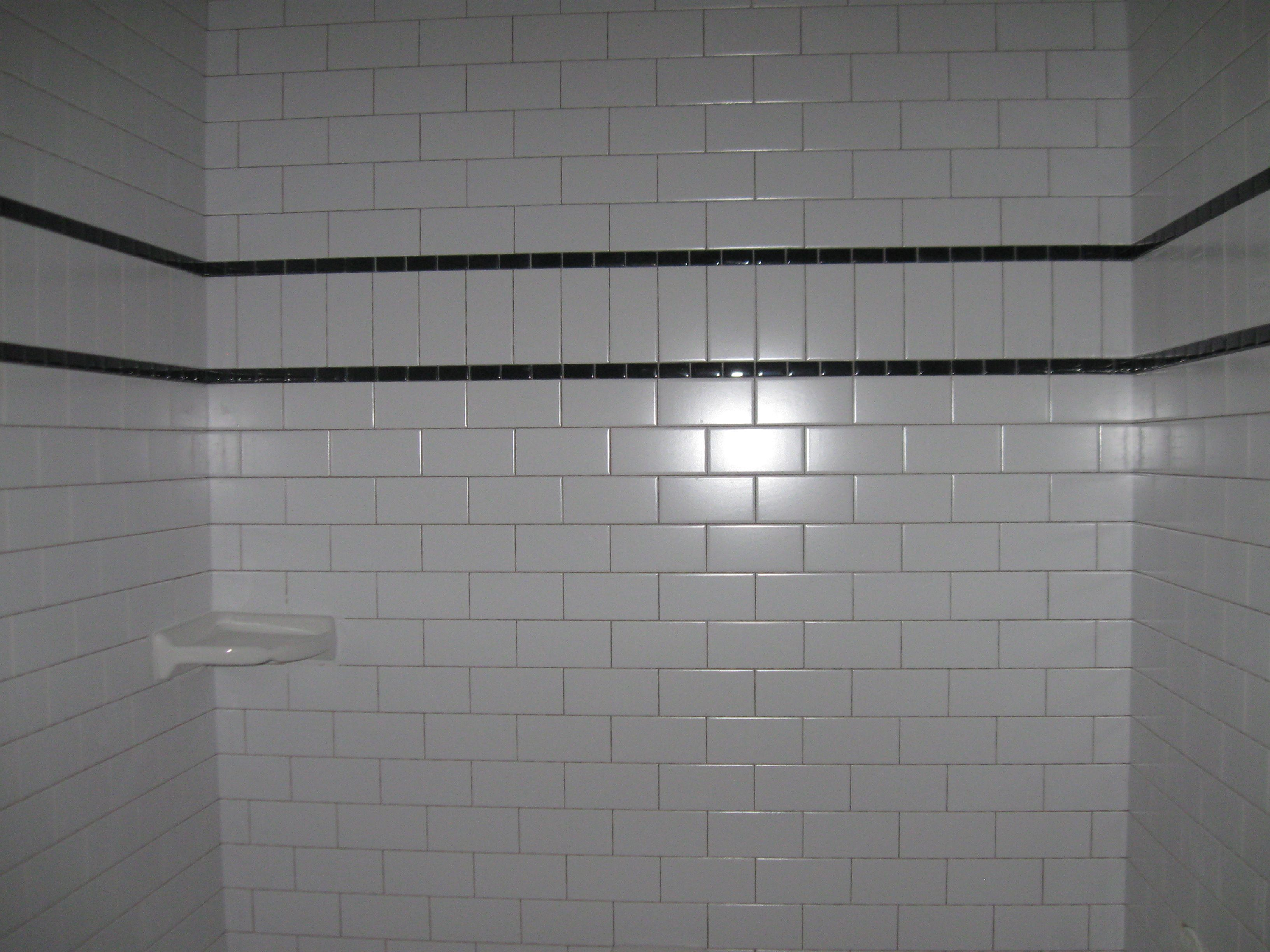 White Subway Tile With Black Accent Band Tiles Run Vertical Within