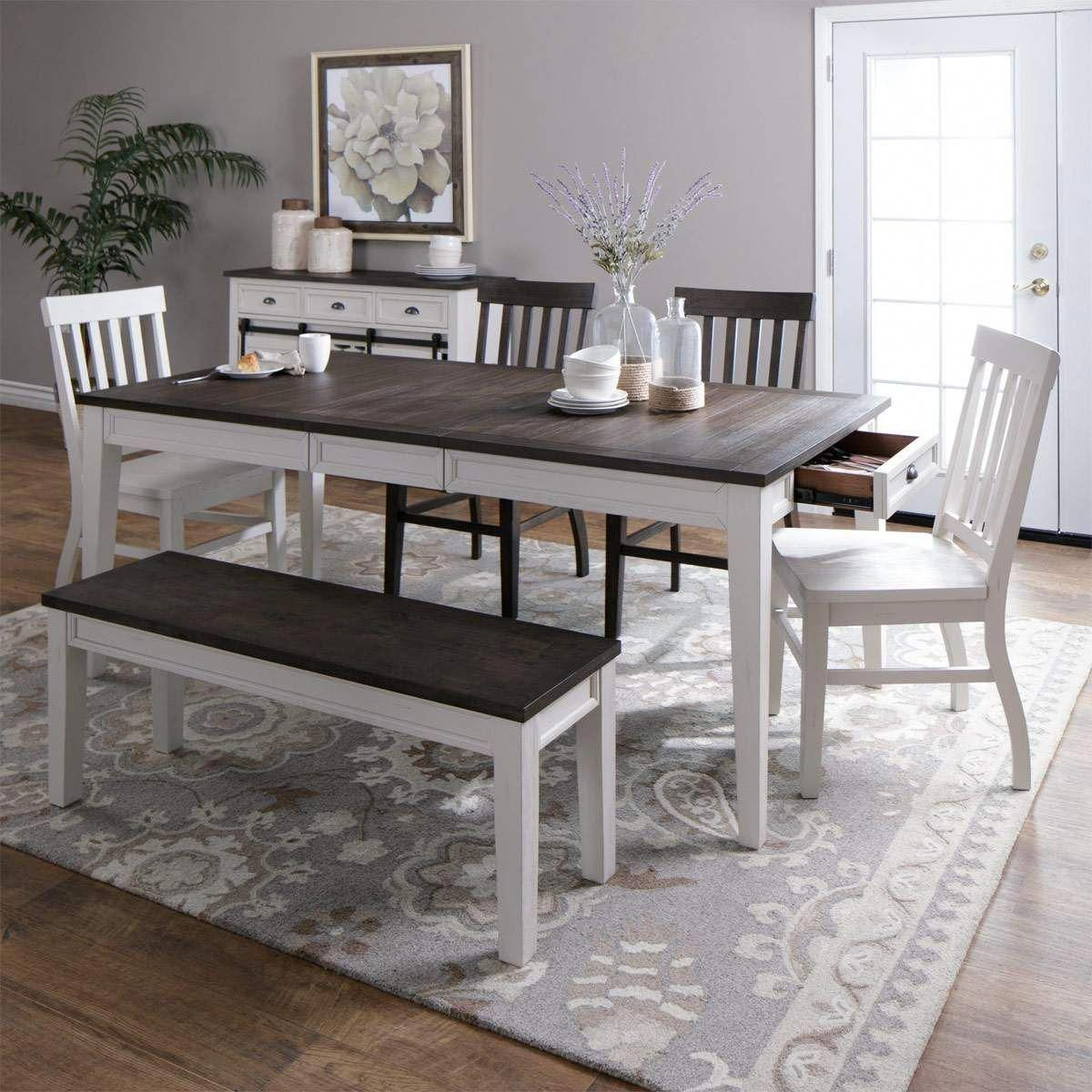 Accommodate a growing family or added guests with the Gramercy two-tone dining table. The 16