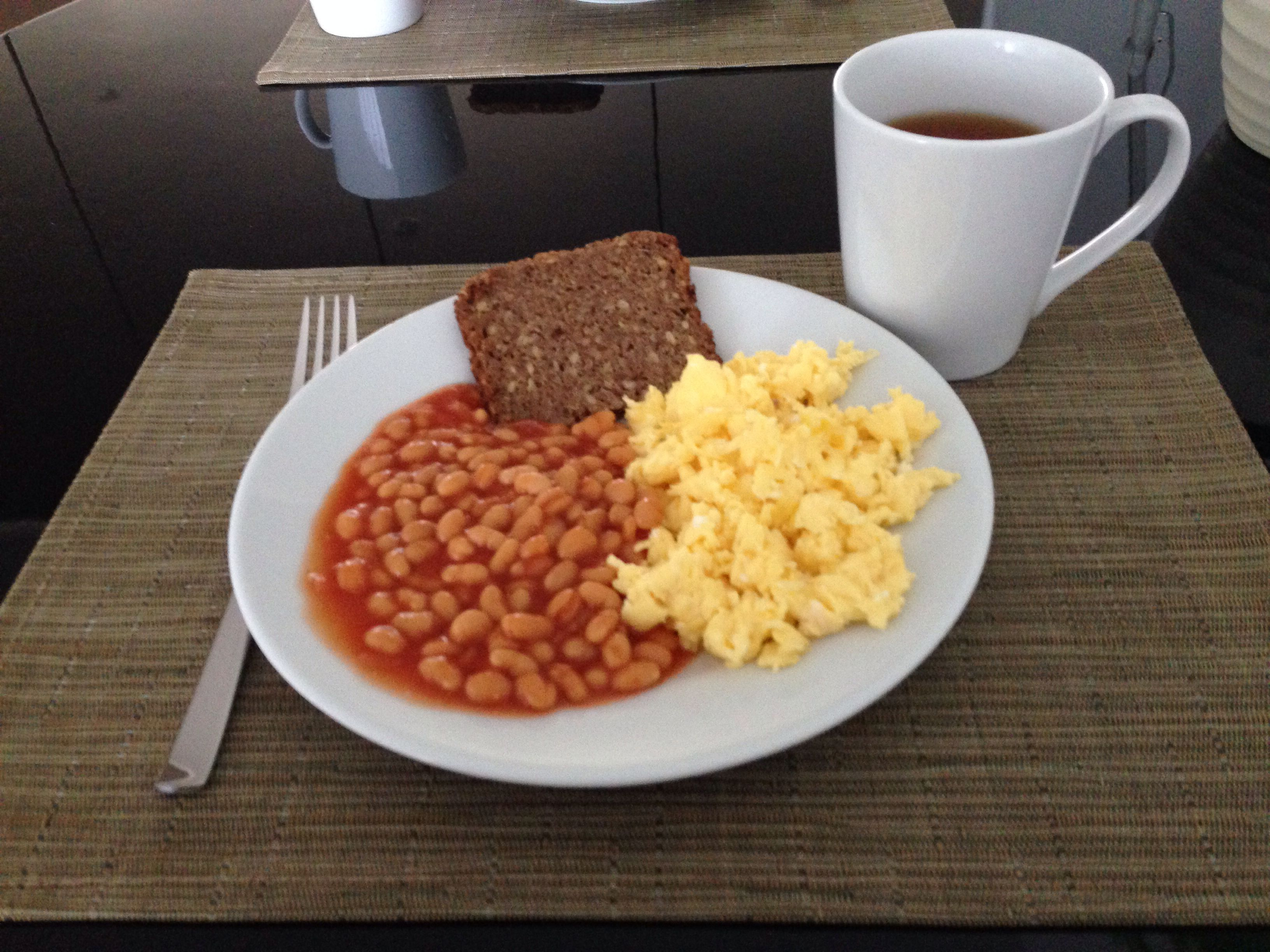 Scrambled eggs, beans, rye bread. 320 calories. 9.8g fibre. Ingredients: 2  eggs, rye bread (30g), baked beans (150g).
