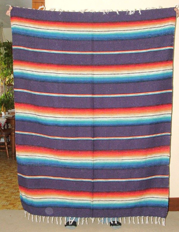 A colorful Mexican style woven blanket in purple for just