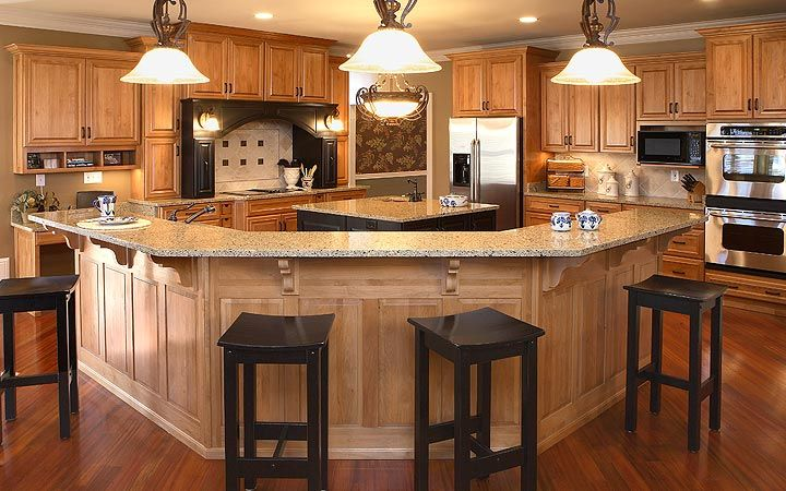 Custom Cabinet Idea #6  Rounded Bar/counter. So No Table Needed Instead Use  Stools. Makes A Smaller Kitchen Bigger And More Space Used!
