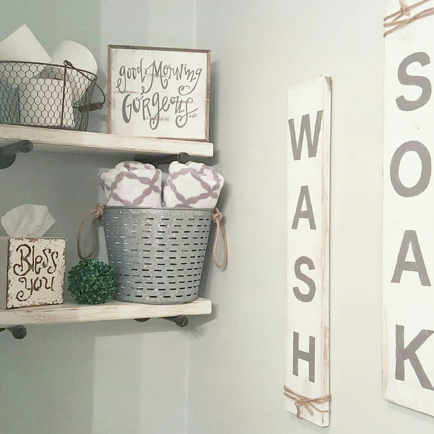 Love the good morning gorgeous sign and the wire basket with toilet paper