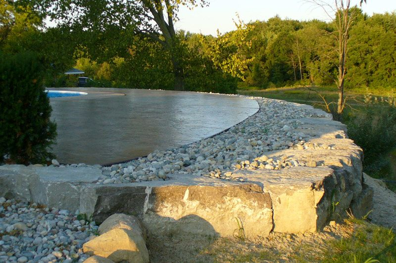 Retaining wall inground pool retaining wall built on the for Pool design retaining wall