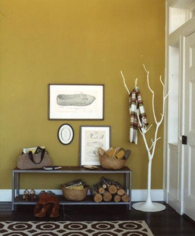 rustic entryway with a bright wall color. I like this yellow for the ...