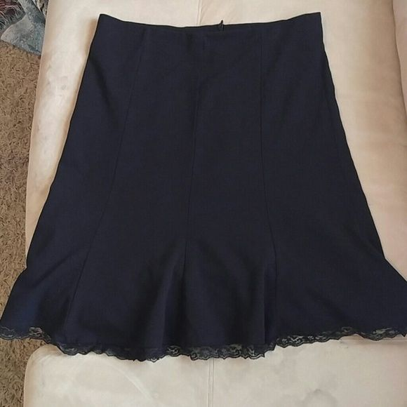 Black A-line knee length skirt Nice skirt with lace detail on the bottom hem. Very flattering. I'm just downsizing and have way too many cute black skirts and not enough time to wear all of them. 21.5 inches from the waist to the bottom of skirt. Limited Skirts Midi