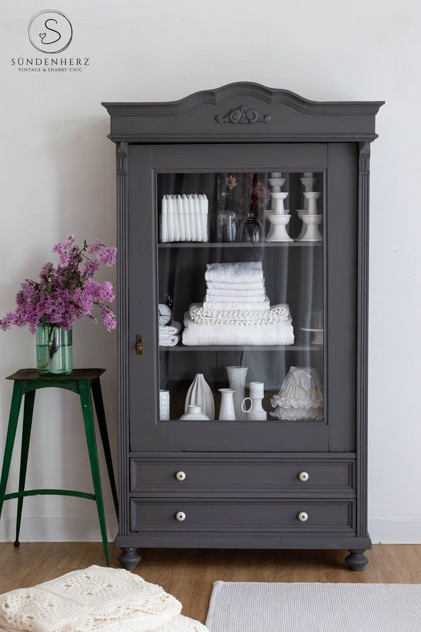 Photo of Shabby chic showcase in french gray, antique cabinet with glass door