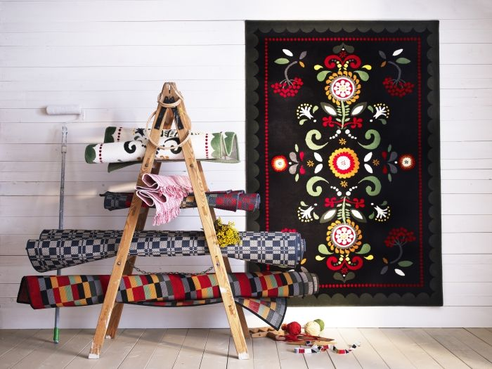 Traditional folk patterns feature in the new ÅKERKULLA rug, seen here alongside other Swedish Country-style rugs.
