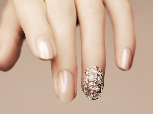 nude with rhinestones nails.