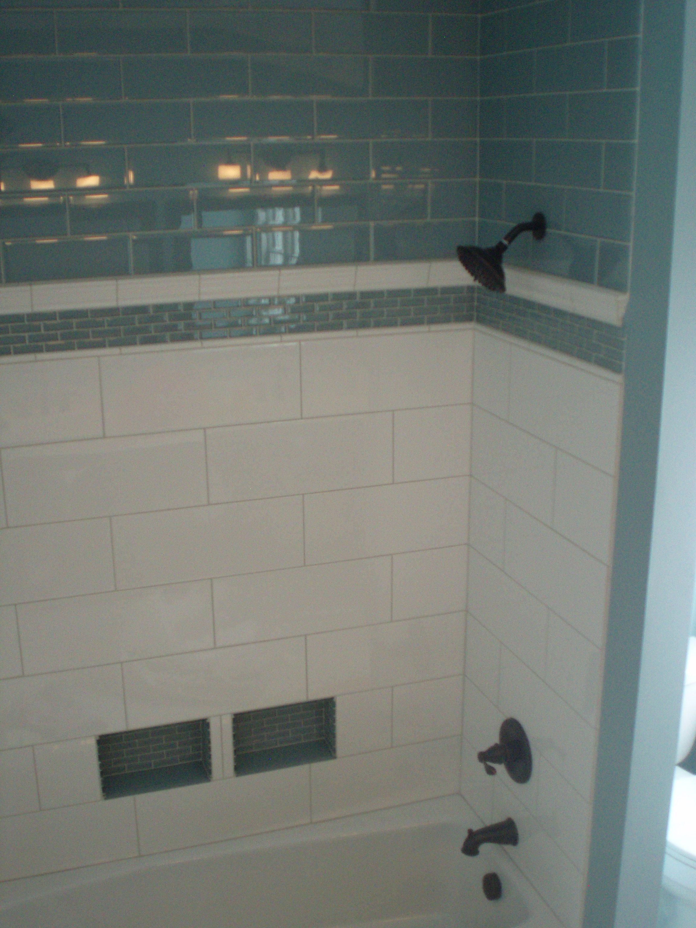Porcelain and glass subway tile are classic The oversized tiles