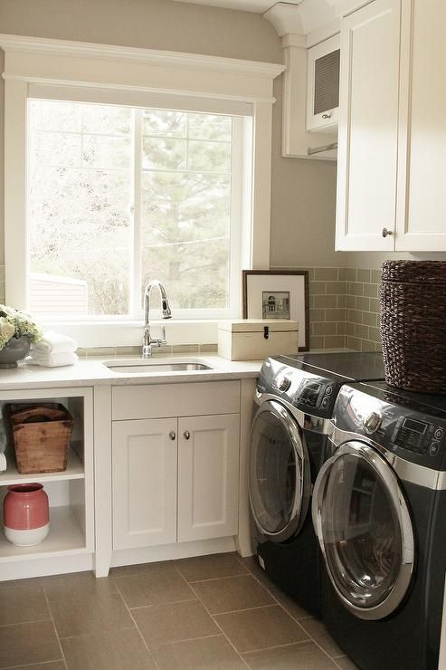 Second Floor Laundry Room Features White Cabinets Paired