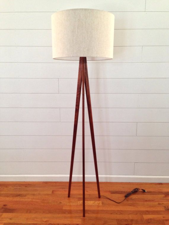 The sleek, tapered legs of this beautiful mahogany tripod floor lamp will blend well with almost any style of home decor. It is constructed with…