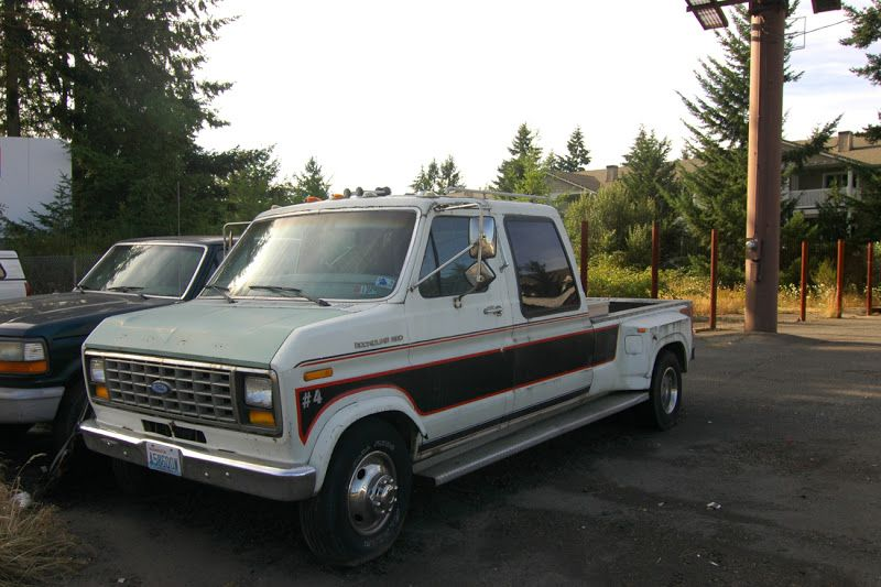OLD PARKED CARS.: 1987 Ford E350 By Cabriolet.