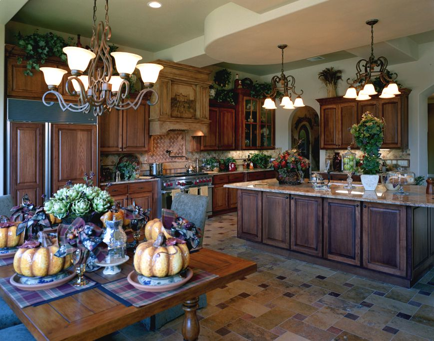 appaling metal chandeliers above kitchen dining area with tuscan style kitchen cabinets and wide island - Tuscan Design Ideas