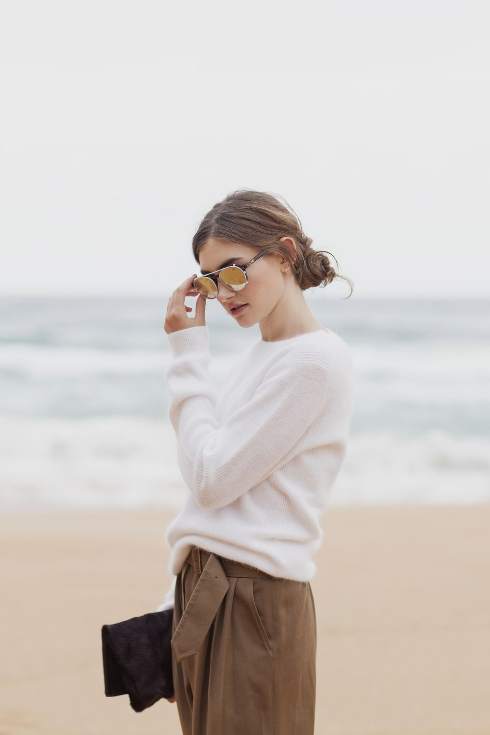 Garrett Leight x Thierry Lasry sunglasses from Bloodorange, Acne sweater  and clutch, Dries Van Noten trousers, Dieppa Restrep...