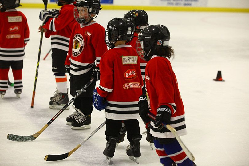 The Campers Line Up For A Drill At Mcfetridge Sports Complex Youth Hockey Hockey Camp Chicago Blackhawks