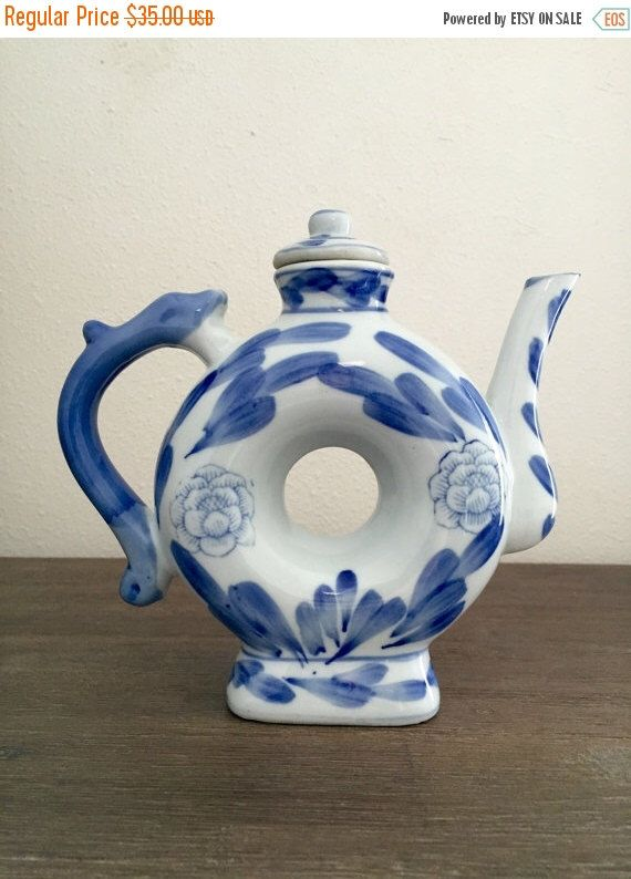 A personal favorite from my Etsy shop https://www.etsy.com/listing/280859868/blue-and-white-hand-painted-porcelain