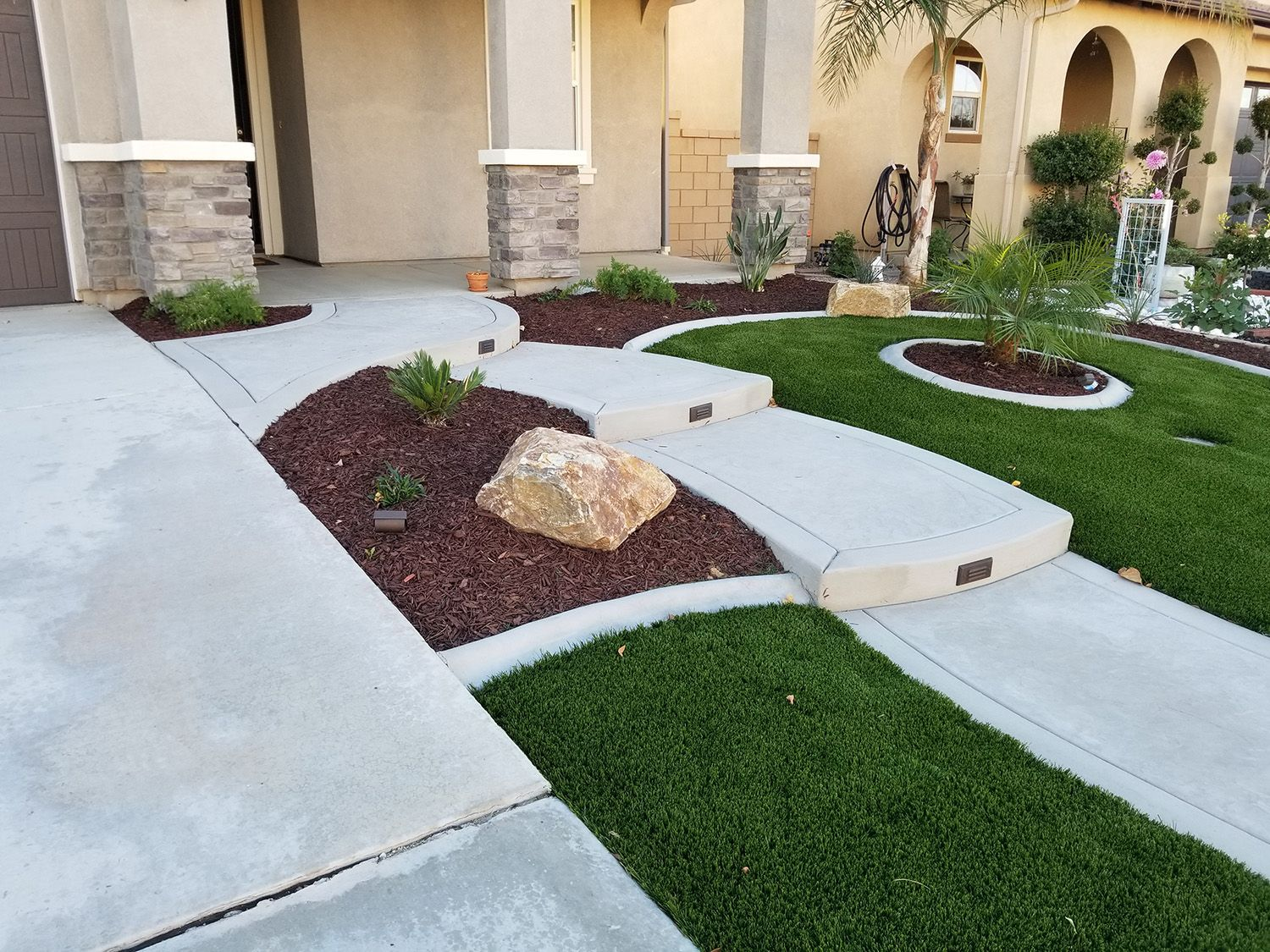 A Residential Front Yard Landscape With Artificial Turf Tropical Plantings A Concrete Wa Front Yard Landscaping Small Front Yard Landscaping Yard Landscaping