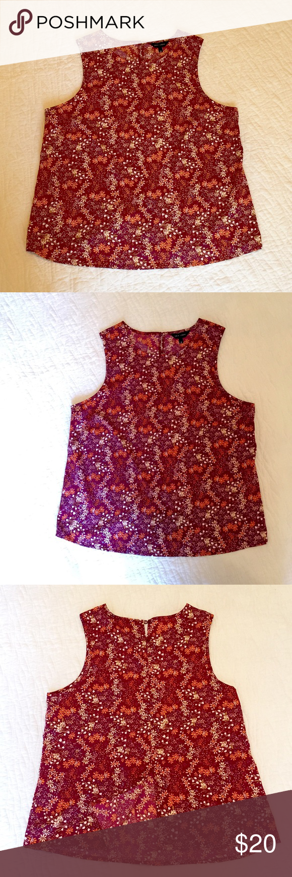 Printed blouse Cute blouse in maroon with white and yellow flower print. Size L. Length: 23 inches. Worn once. Slit on the back (see the last picture). Unlined, light and airy top. Tops Blouses