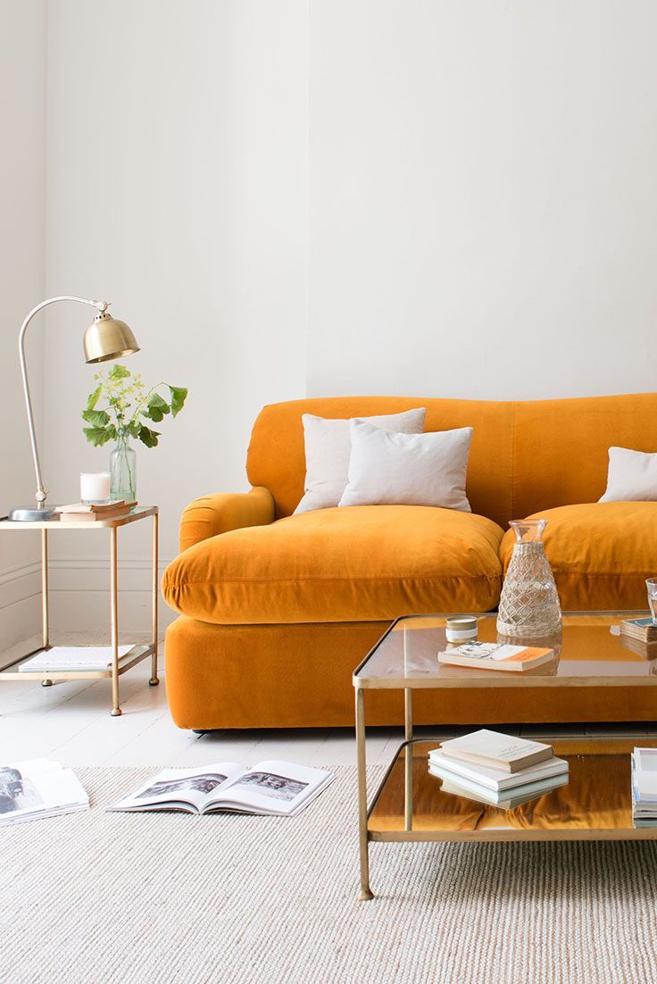 E Your Living Room Up With This Bright Orange Sofa In Whitewash The Velvet Fabric On Draws Eye