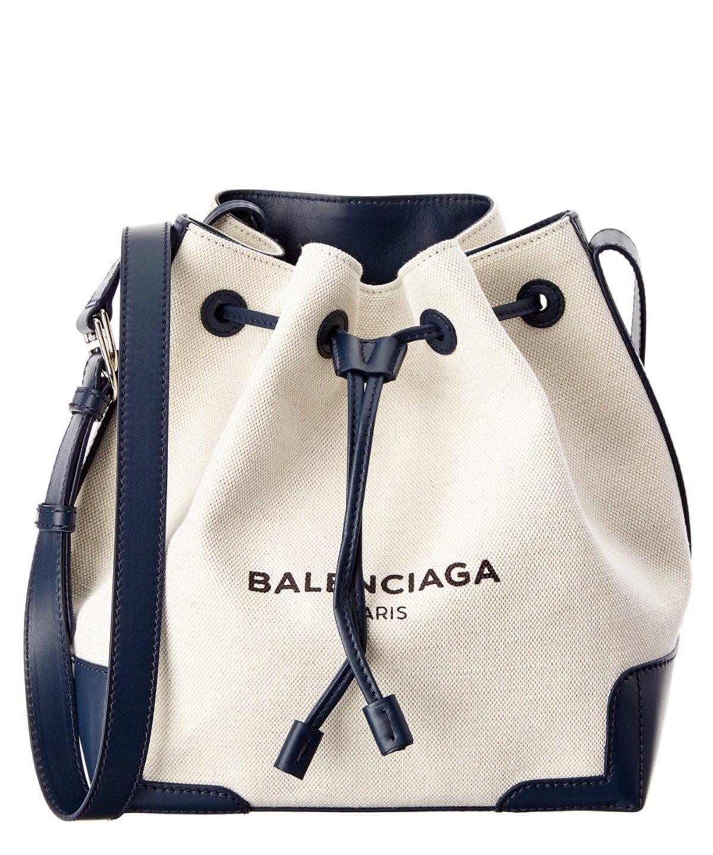 57ea4263f BALENCIAGA Balenciaga Navy Small Canvas &Amp; Leather Bucket Bag'. # balenciaga #bags #shoulder bags #leather #canvas #bucket #lining #