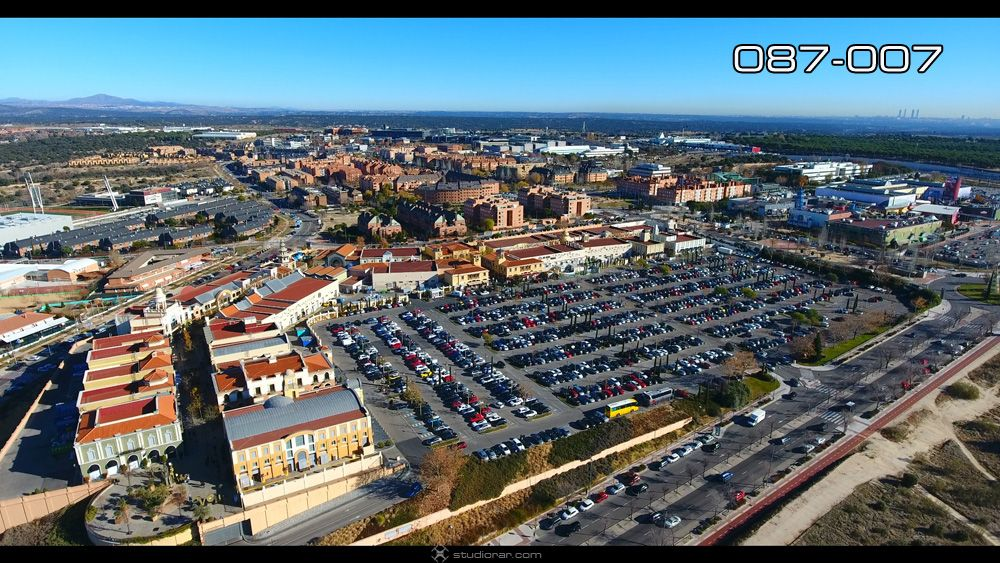 Vertical view of cars at shopping center parking lot
