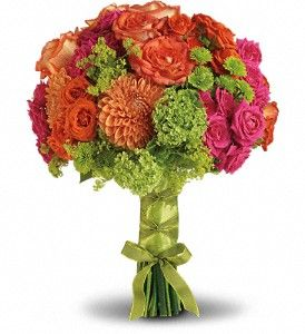 Orange and hot pink roses are perfectly paired with orange dahlias, green hydrangea and button spray chrysanthemums, plus green viburnum and accents of lady's mantle.