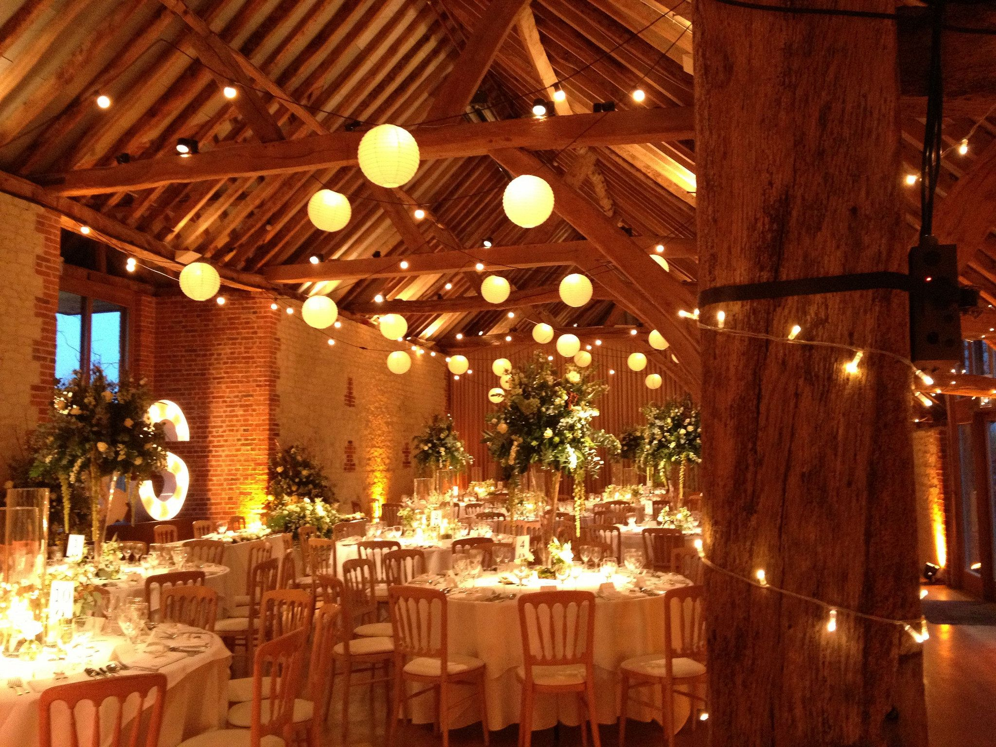 White paper lanterns with lights - Bury Court Barn Festoon Lights And White Paper Lanterns Wall Uplighters In Amber By