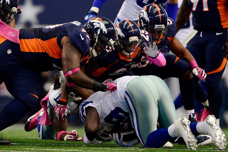 Kevin Vickerson (99) of the Denver Broncos, Chris Harris (25) and Wesley Woodyard (52) make a stop on DeMarco Murray (29) of the Dallas Cowb... #ProFootballDenverBroncos