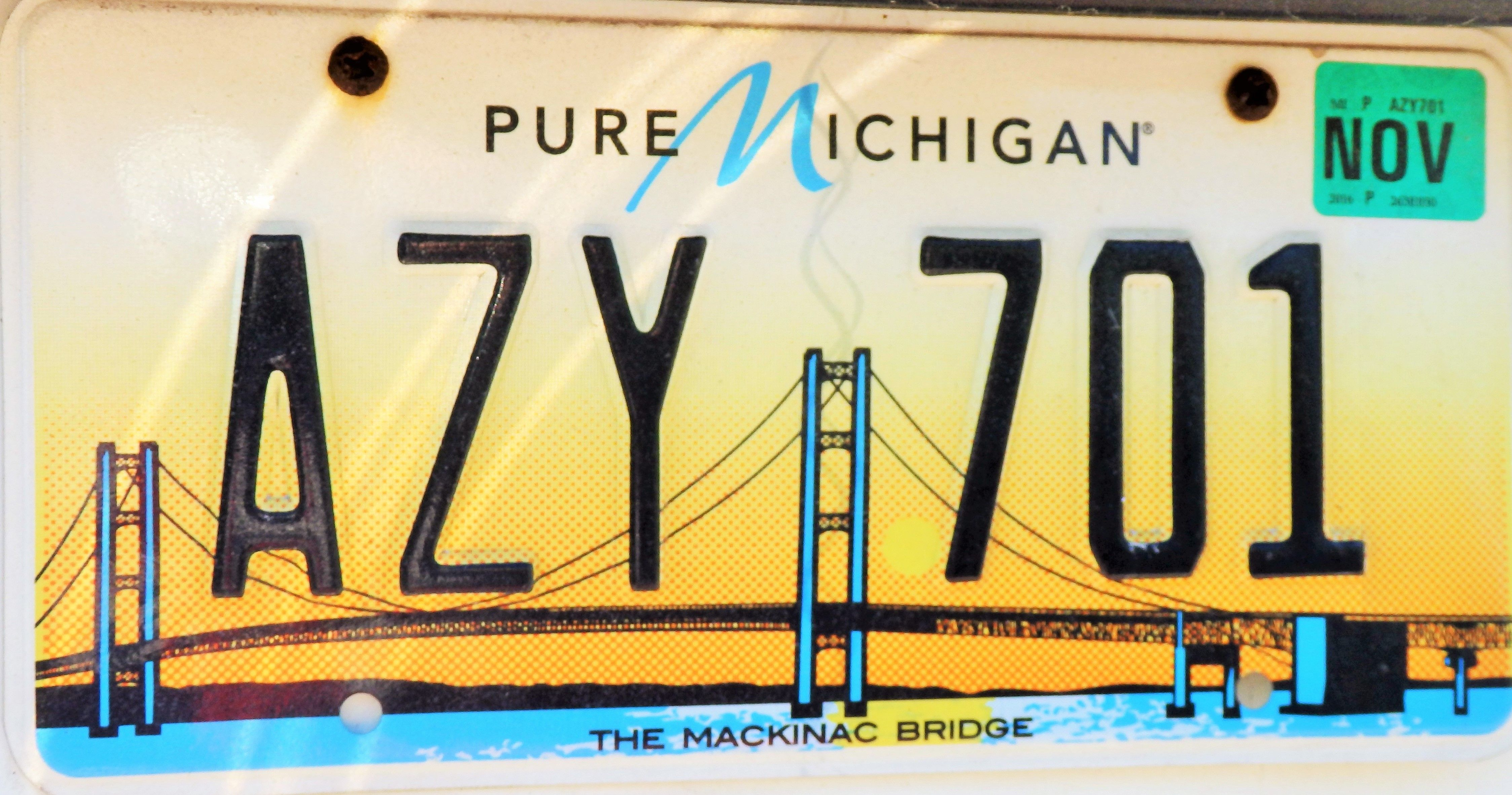 What do i need to register my car in michigan