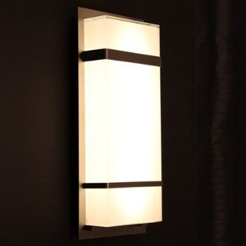 The modern forms phantom indoor outdoor led wall sconce is sharp stylish outdoor accent lighting made to last a mitered silk screened glass shade is