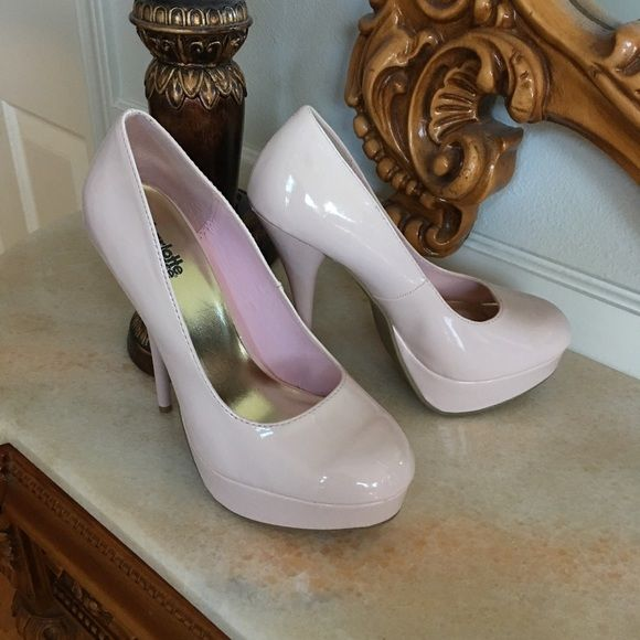 Charlotte Russe platform heels 7 Pastel pink 5 1/2 inch pump with 1 1/4 in plat form. Worn once. Size 7 Charlotte russe  Shoes Heels
