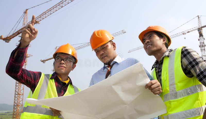Construction Teamwork Group Asian Architect Wearing A Safety Vest